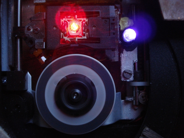 The laser beam (centre) and UV diode (right). Credits: CNES.