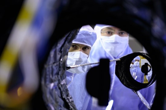 Technicians work on the 1st Pleaides telescope. Credit: CNES.