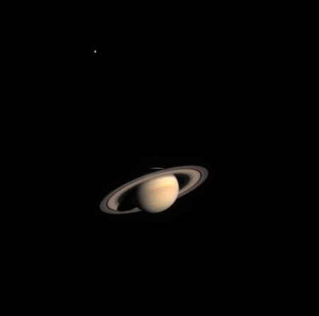 Saturn and the satellite Titan, top left. Credits: ESA/NASA/ASI.