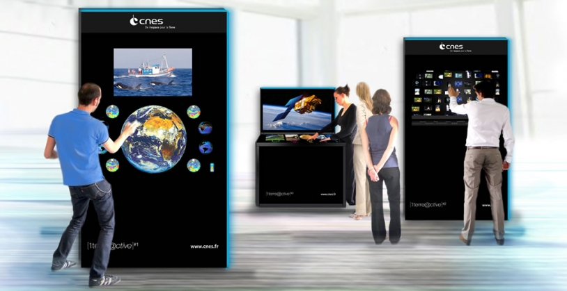 Inside the pavilion, 2 interactive terminals and a multi-touch table showcase France's space activities. Credits: CNES.