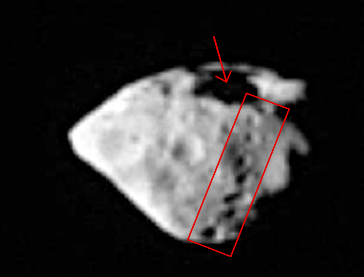 The large surface crater spanning about 2 km and the string of smaller craters lower down are the remnants of a very violent impact between Steins and another asteroid. Credits: OSIRIS/MPS/LAM/University of Padua.