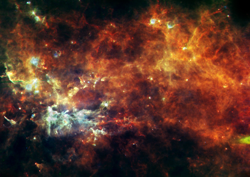 Entire assembly line of newborn stars in the constellation of Vulpecula. Crédits: ESA/Hi-GAL Consortium.