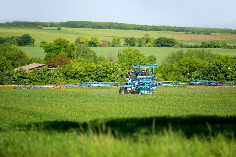 Crop spraying with a tractor. Credits: Phovoir/, 2010.