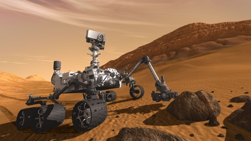 Impression of the MSL Curiosity rover at work on the planet surface. Credits: NASA/JPL-Caltech.