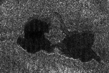 "This Cassini radar image shows two lakes ""kissing"" each other on the surface of Saturn's moon Titan. Copyright : NASA/JPL."